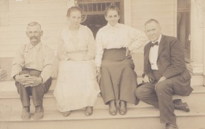 Two couples sit on a porch.