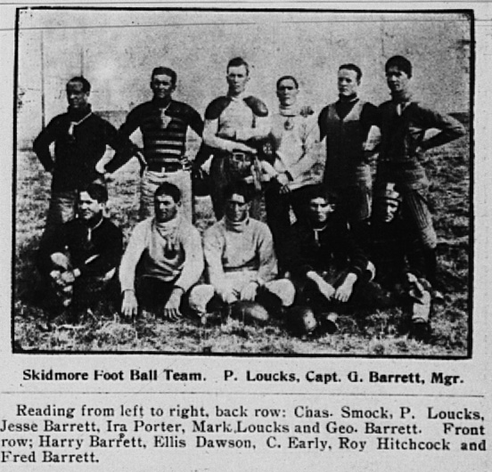Eleven men, some in early football gear, pose together for the camera.  From the December 12, 1908 Skidmore New Era (Skidmore, Missouri), page 3.  Back row:  Charles Smock, P. Loucks, Jesse Barrett, Ira Porter, Mark Loucks and George Barrett.  Front row:  Harry Barrett, Ellis Dawson, C. Early, Roy Hitchcock and Fred Barrett.