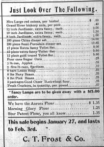 Advertisement - Just Look Over the Following.  The ad features prices for red onions, hickory nuts, a 100-piece China dinner set for $14.00, a 3-pound can of apples for 35 cents, two five-pound cans of sardines for ten cents, 8 pounds of navy beans for 25 cents, 3 packages of Good Cheer Buckwheat flour for 25 cents, and fresh crackers for seven cents a pound.  Fancy Lamps were given away with a $15.00 purchase.